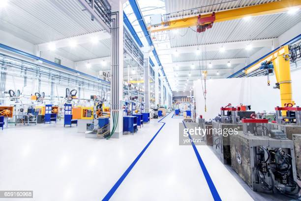 modern factory & aisle - flooring stock photos and pictures