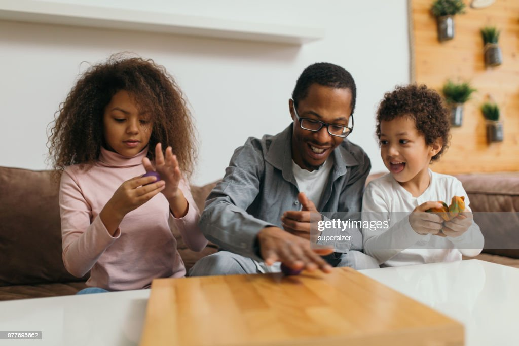 Family of four is spending fun time at home