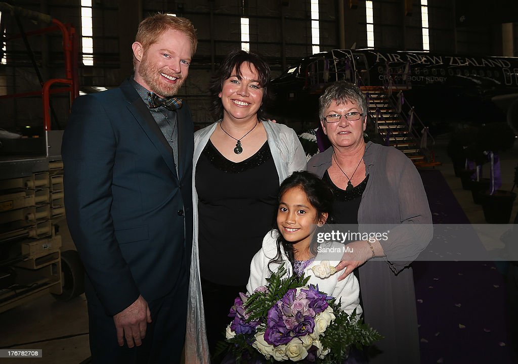 Modern Family actor Jesse Tyler Ferguson (L) poses with the newly wed couple Lynley Bendall and Ally Wanikau (R) and their daughter Maycee after arriving at the Air New Zealand hanger on August 19, 2013 in Auckland, New Zealand.