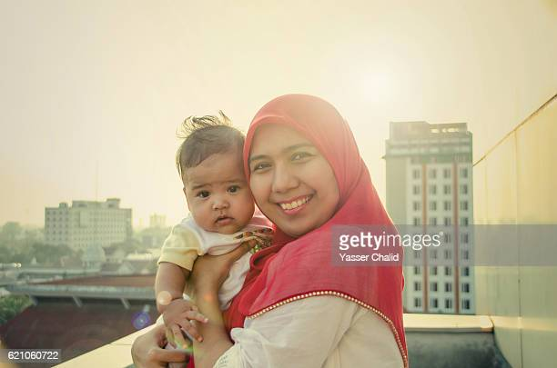 modern family - muslim mother stock pictures, royalty-free photos & images