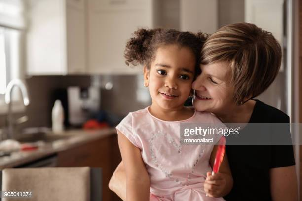 modern family portrait of grandmother and her granddaughter - mixed race person stock pictures, royalty-free photos & images