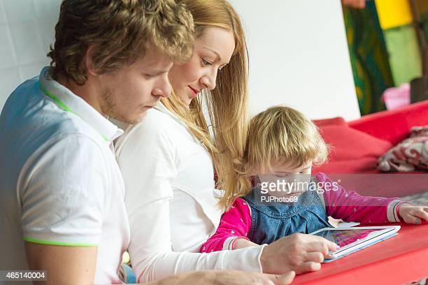 Modern family using Digital Tablet