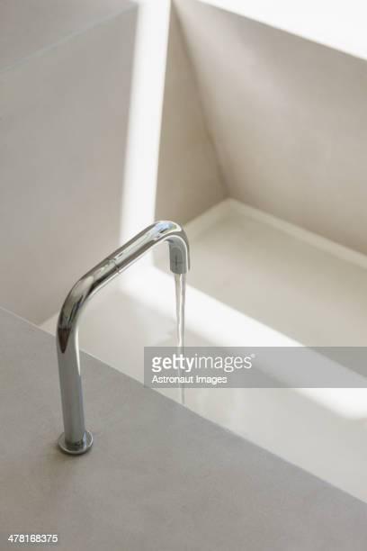 Modern faucet filling bathtub