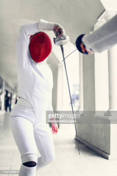 Modern Fencer Parrying Opponent's Jab
