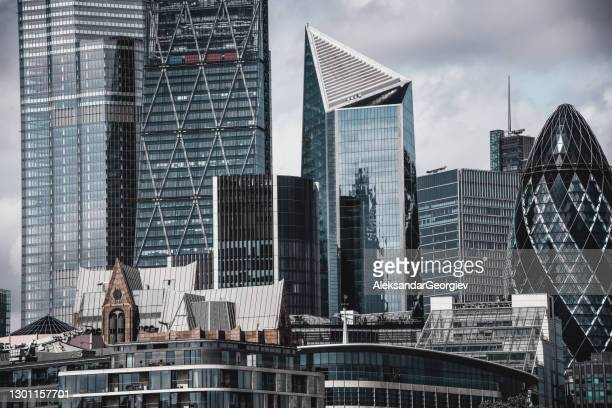 modern financial district buildings in london, uk - national landmark stock pictures, royalty-free photos & images