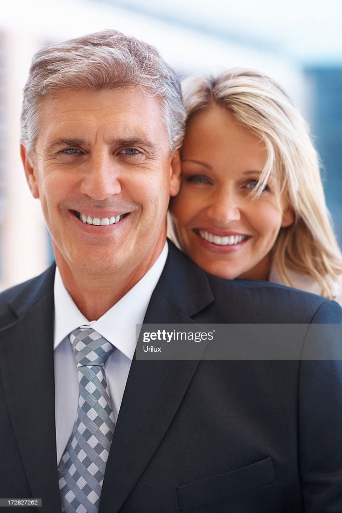 Modern Formally Dressed Couple Looking At You Stock Photo Getty Images