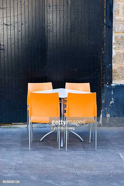 modern furniture against black wooden door - lyn holly coorg stock pictures, royalty-free photos & images