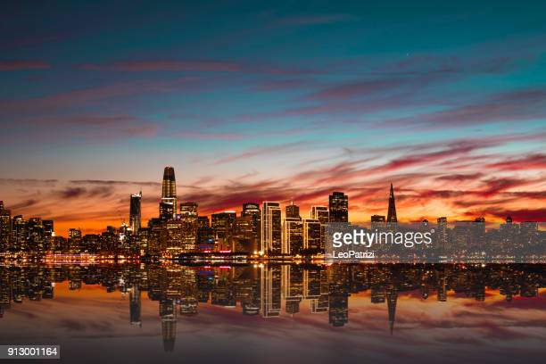 modern futuristic downtown san francisco skyline at night - treasure island california stock pictures, royalty-free photos & images