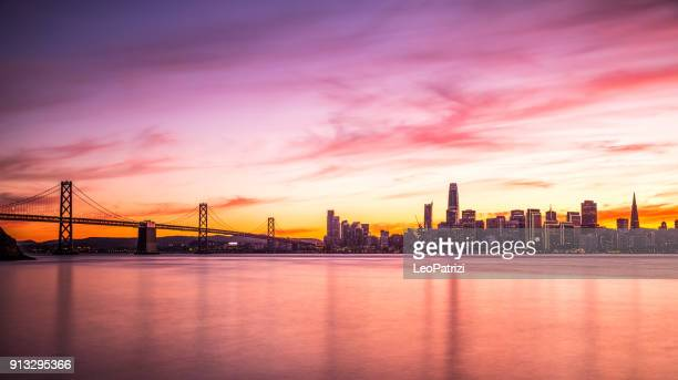 modern futuristic downtown san francisco skyline at night - san francisco california stock photos and pictures
