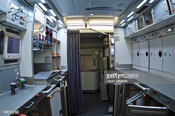 A modern galley kitchen in a jet airliner with storage compartments.