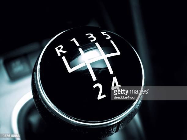 Modern gearstick of a sport car on black