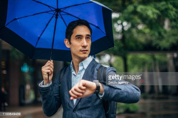 modern gentleman checking the time on the street - charming stock pictures, royalty-free photos & images