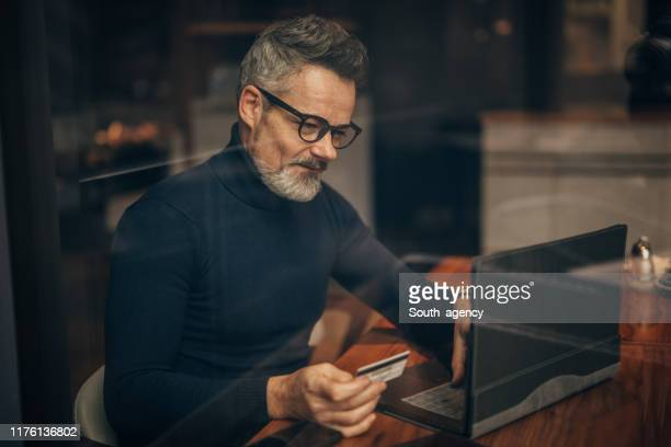 modern gentleman using laptop in cafe - polo neck stock pictures, royalty-free photos & images