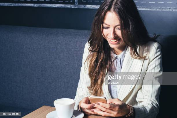 modern girl sitting at table drinking
