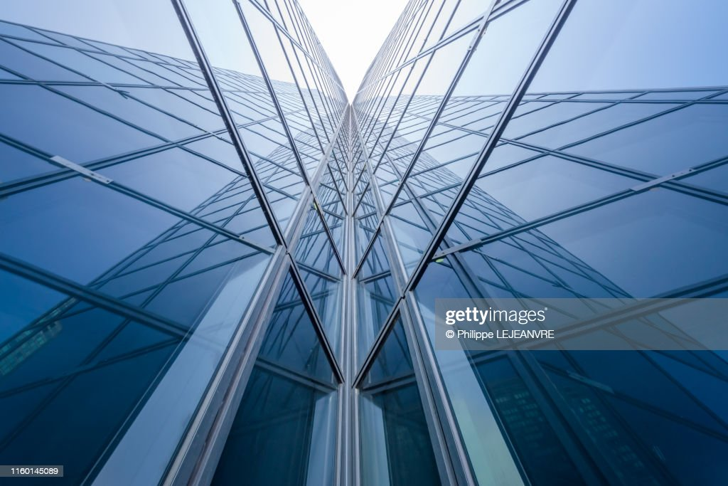 Modern glass building mirror reflections : Stock Photo