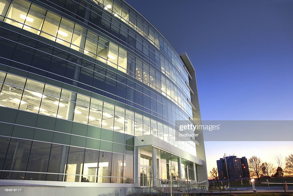 Modern glass office building at sunset : Stockfoto
