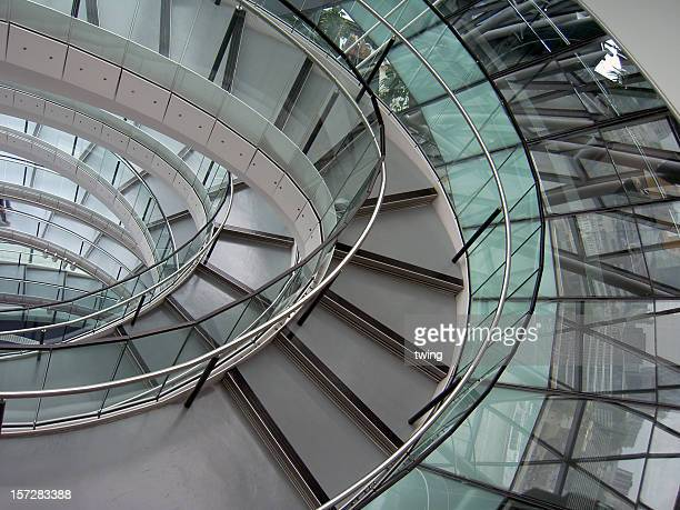 Modern glass spiral staircase with windows