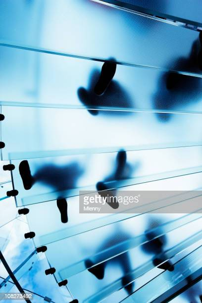 modern glass staircase with people - steps stock photos and pictures