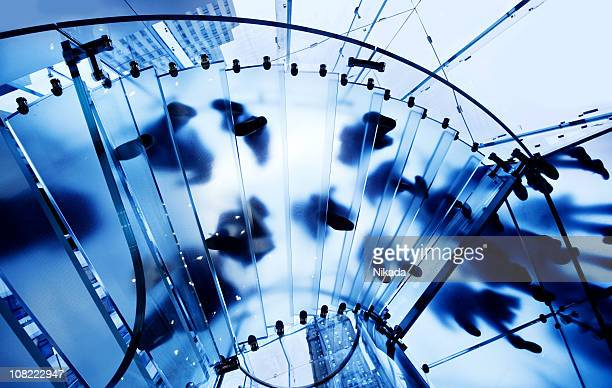 Modern Glass Staircase with Silhouettes of People