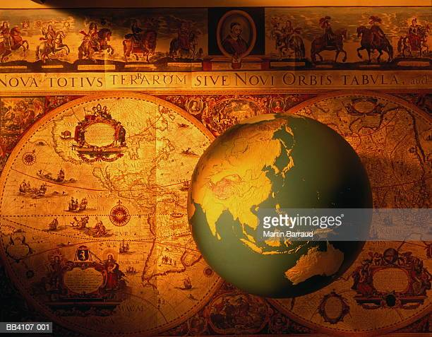 modern globe showing australasia and asia, against antique map - オーストラレーシア ストックフォトと画像