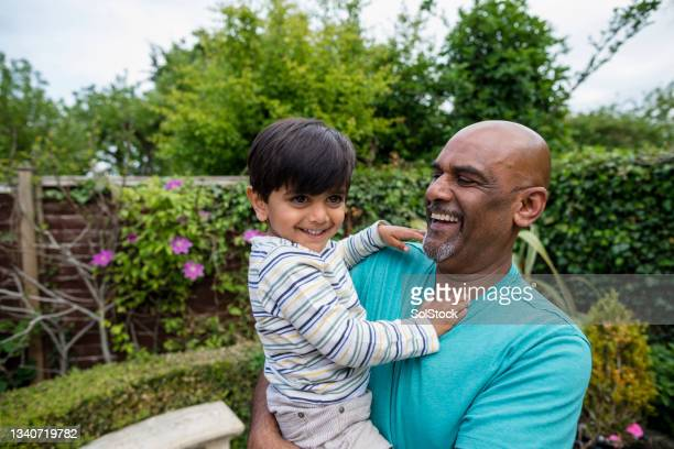 modern grandfather - middlesbrough stock pictures, royalty-free photos & images