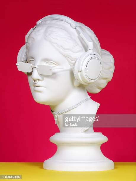 modern greek goddess with headphones - roman stock pictures, royalty-free photos & images