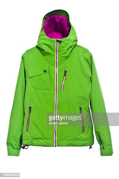 Modern green ski jacket isolated on white background, studio shot
