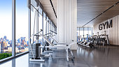 Modern gym interior with city view , 3d rendering