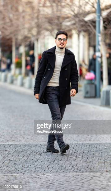 modern handsome  man in winter coat. - coat stock pictures, royalty-free photos & images