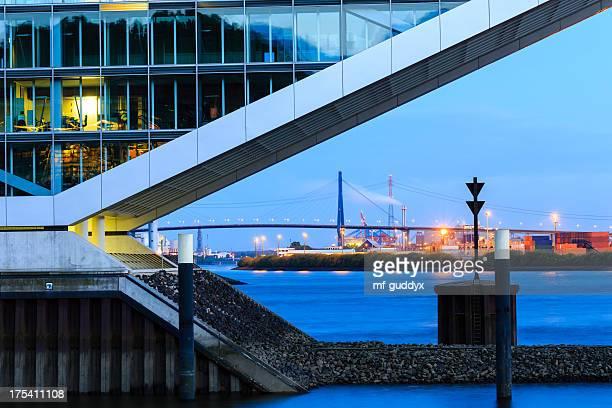 modern harbour - office building - köhlbrandbrücke stock photos and pictures