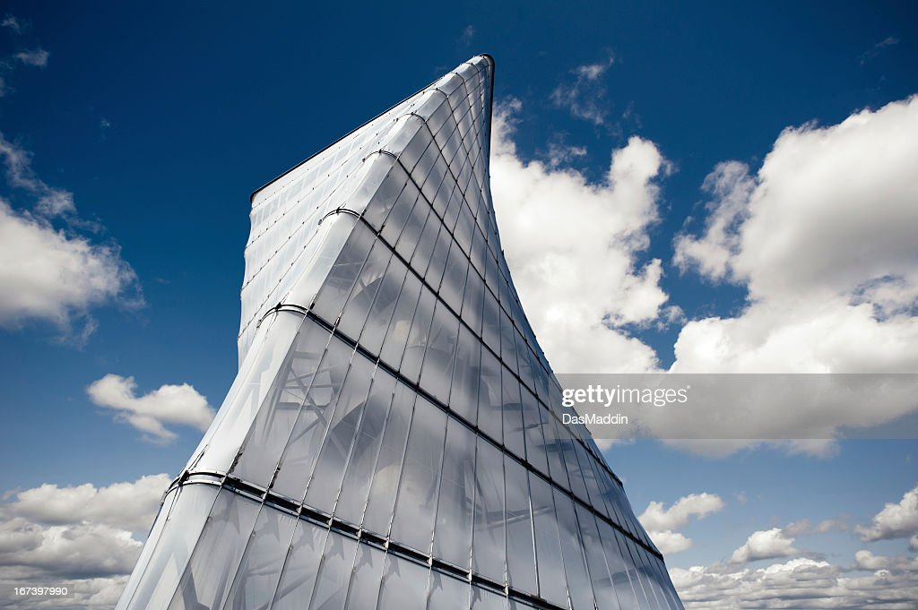 Modern helix tower with blue cloudy sky : Stock Photo