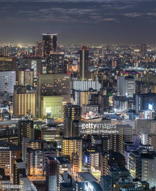 modern high rise buildings at night in osaka, japan. - 金融と経済 ストックフォトと画像