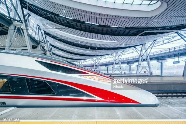 modern high speed trains in beijing, china - railroad stock pictures, royalty-free photos & images