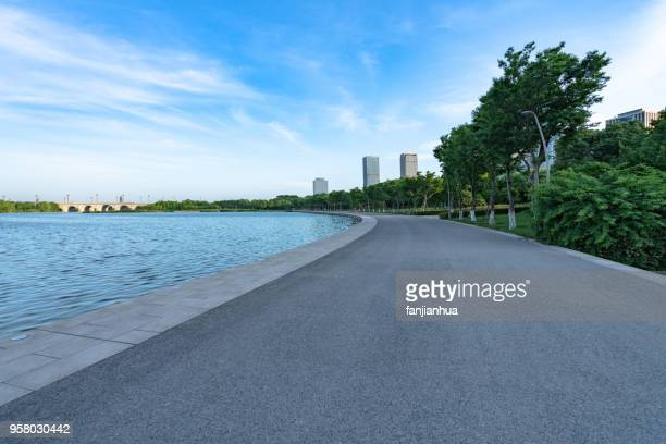 modern highrise building at urban waterfront - waterfront stock pictures, royalty-free photos & images