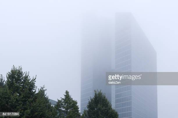 Modern high-rise office building disappearing in fog, Munich, Bavaria, Germany, Europe