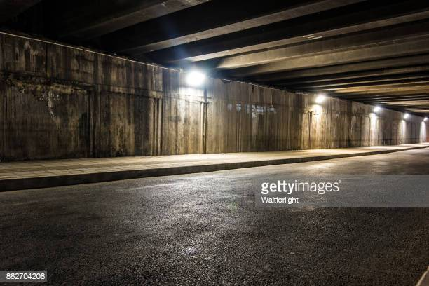 modern highway tunnel - empty road stock pictures, royalty-free photos & images