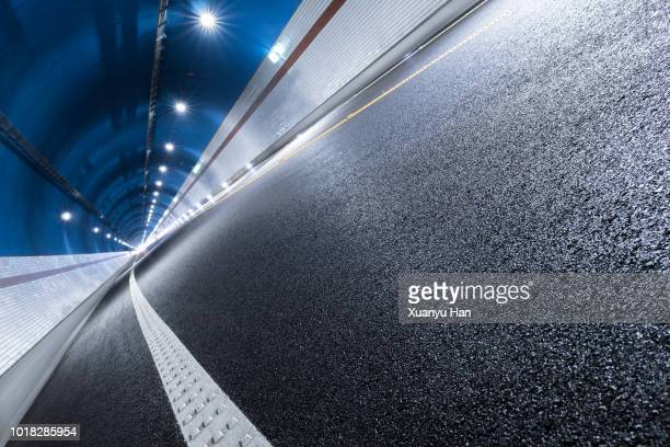modern highway tunnel underpass - unusual angle stock pictures, royalty-free photos & images