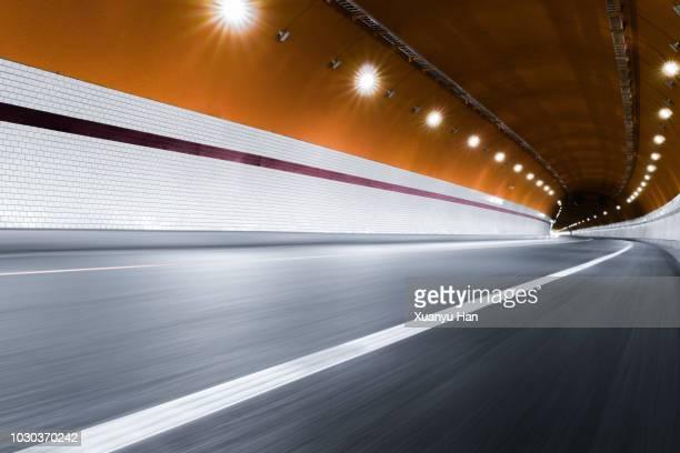 modern highway tunnel underpass - gold rush stock-fotos und bilder