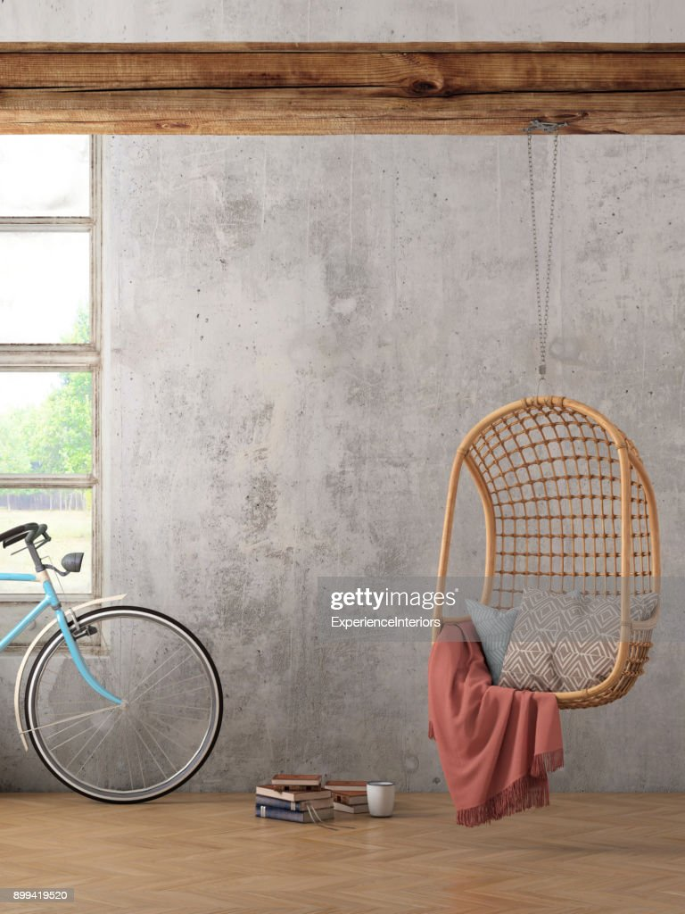 modern hipster interior with pendant chair and a bicycle wall