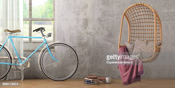 Modern hipster interior with pendant chair and a bicycle wall template