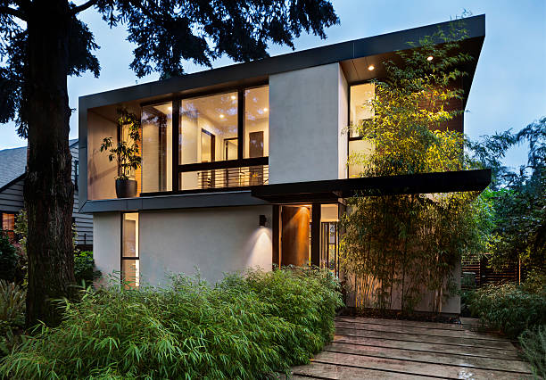 modern home exterior lit at twilight - modern stock pictures, royalty-free photos & images