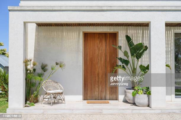 modern home front door and porch in buenos aires - front door stock pictures, royalty-free photos & images