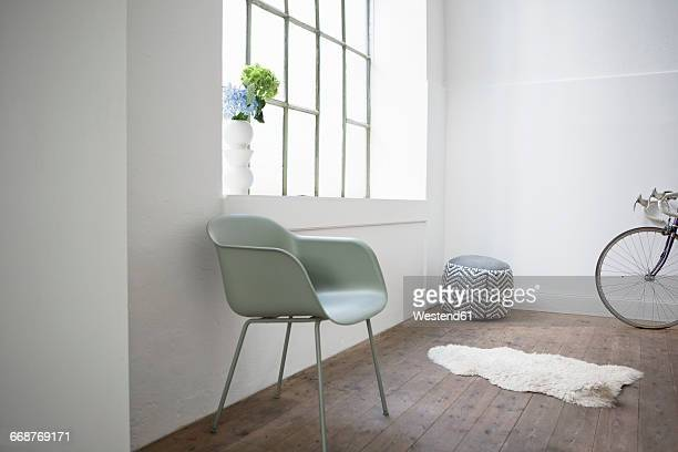 Modern home interior, chair and stool at window