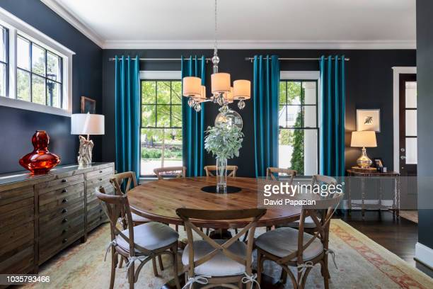 modern home with a contemporary interior dining room - dining room stock photos and pictures