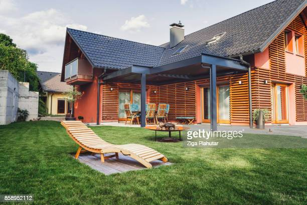 modern home with back yard - roof stock photos and pictures