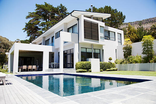modern home with swimming pool - modern stock pictures, royalty-free photos & images