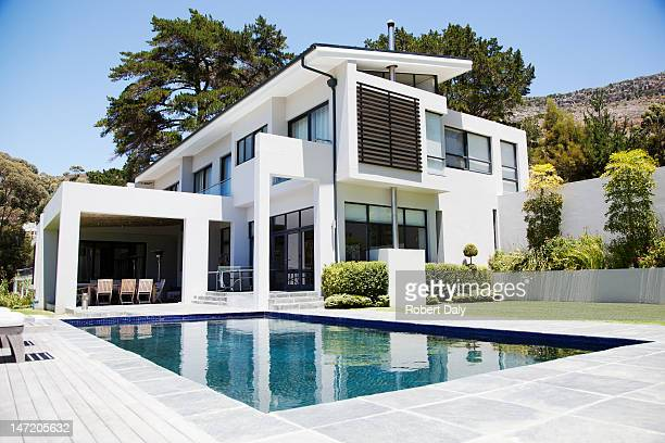 modern home with swimming pool - house stock pictures, royalty-free photos & images