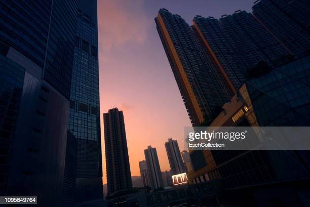 Modern Hong Kong cityscape with billboard display at sunset
