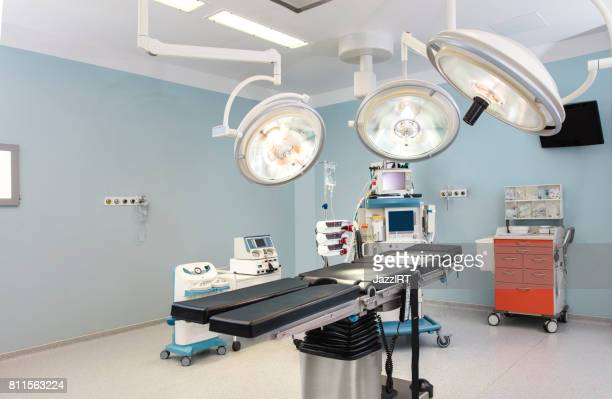 Modern hospital operating room with monitors and equipment