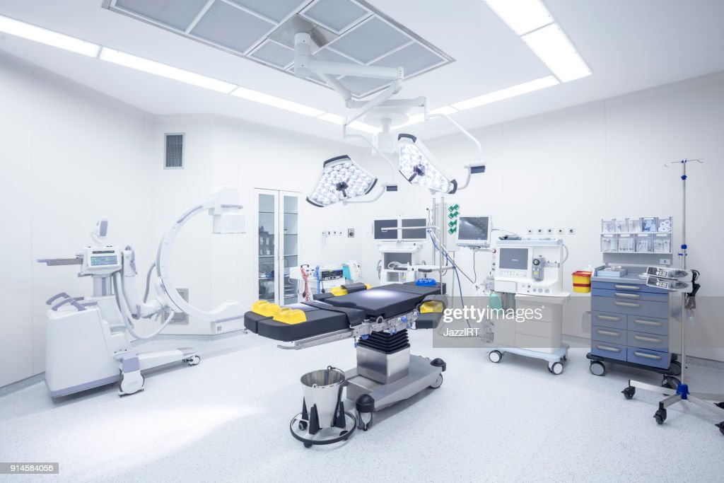 Modern hospital operating room with monitors and equipment : Stock Photo